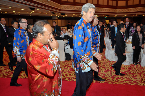 U.S. Secretary of State John Kerry and fellow foreign ministers, all clad in batik shirts favored in Brunei, enter a gala dinner at the ASEAN ministerial meeting in Bandar Seri Begawan on July 1, 2013. [State Department photo/ Public Domain]