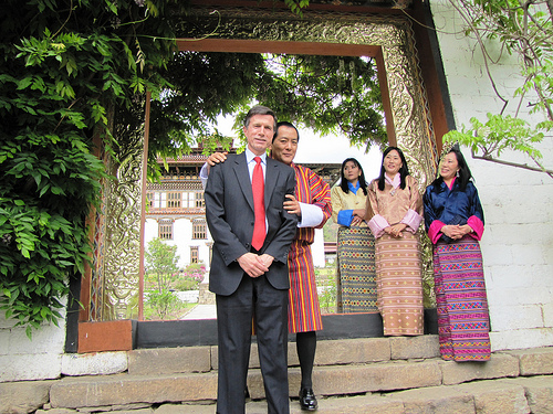 Assistant Secretary of State for South and Central Asian Affairs Robert Blake, the Fourth King of Bhutan Jigme Singye Wangchuk, and three of his wives pose for a photo in front of Dechencholing Palace, in Thimphu, Bhutan, on April 29, 2010. [State Department Photo/Public Domain]