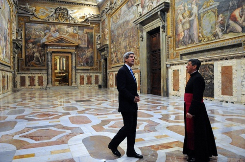 Vatican Chief of Protocol Monsignor Jose Bettancourt gives U.S. Secretary of State John Kerry a tour of the Apostolic Palace in Vatican City during a visit to Rome, Italy, on January 14, 2014. [State Department photo/ Public Domain]