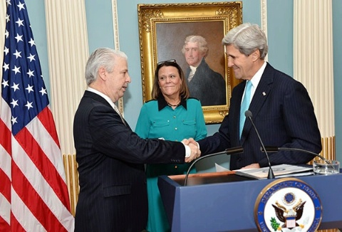 As his wife looks on, Gregory B. Starr (left) is congratulated by U.S. Secretary of State John F. Kerry (right) immediately after Mr. Kerry swore him in as Assistant Secretary for Diplomatic Security during a ceremony at State Department headquarters in Washington D.C., January 8, 2014.  Mr. Starr is the first Diplomatic Security special agent to hold the position of Assistant Secretary. (U.S. Department of State photo)