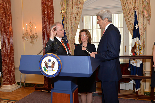 Secretary Kerry Swears in Ambassador Broas With Julie Broas looking on, U.S. Secretary of State John Kerry swears in Tim Broas as U.S. Ambassador to the Netherlands at the U.S. Department of State in Washington, D.C., on April 10, 2014. [State Department photo/ Public Domain]