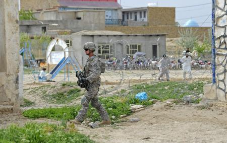 Spc. Jonathan Smith pulls security outside the Sheik Mati Boys School in Qalat, Afghanistan, while members of Provincial Reconstruction Team Zabul assess the school's dining hall and kitchen for future renovations, April 16. Smith is part of PRT Zabul's security force. Photo via DVIDS: Staff Sgt. Brian Ferguson 4.16.2011