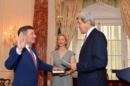 Secretary Kerry Swears in Ambassador Rivkin as Assistant Secretary With his wife, Susan Tolson, looking on, U.S. Secretary of State John Kerry swears in Ambassador Charles Rivkin as Assistant Secretary for Economic and Business Affairs at the U.S. Department of State in Washington, D.C., on April 15, 2014. [State Department photo/ Public Domain]