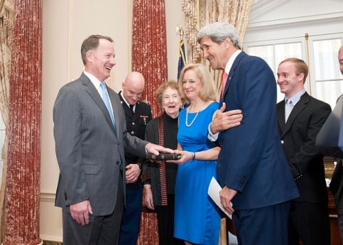 Secretary Kerry Shares a Laugh With Assistant Secretary Smith U.S. Secretary of State John Kerry shares a laugh with Daniel Smith and his family after swearing him in as the Assistant Secretary of State for Intelligence and Research at the U.S. Department of State in Washington, D.C., on April 24, 2014. [State Department photo/ Public Domain]