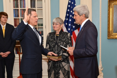 Secretary Swears in Ambassador Tueller With his family looking on, U.S. Secretary of State John Kerry swears in Ambassador Matthew Tueller as the U.S. Ambassador to Yemen, at the U.S. Department of State in Washington, D.C., on May 8, 2014. [State Department photo/ Public Domain]