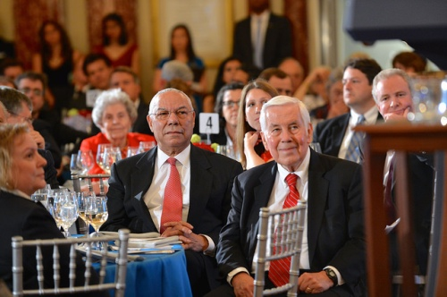 Former Secretary Colin Powell and former Senator Richard Lugar listen as U.S. Secretary of State John Kerry delivers remarks at an event celebrating the 90th Anniversary of the United States Foreign Service at the U.S. Department of State in Washington, D.C., on May 22, 2014. The modern Foreign Service was created on May 24, 1924, with the passage of the Rogers Act establishing the current merit-based, professional Foreign Service. [State Department photo/ Public Domain]