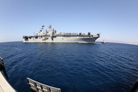 The USS Bataan (LHD-5) prepares to dock at the Royal Jordanian Naval Base in the Port of Aqaba in Jordan to participate in training scenarios with regional partners during Exercise Eager Lion 2014, May 23. Exercise Eager Lion is a recurring, multi-national exercise designed to strengthen military-to-military relationships and enhance regional security and stability by responding to modern-day security scenarios. (U.S. Marine Corps photo by Sgt. James A. Hall/Released)