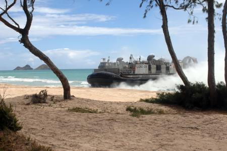 A landing craft air cushioned assigned to Beach Master Unit 1 arrives to offload vehicles supporting a mock embassy evacuation during Rim of the Pacific 2008. RIMPAC is the world's largest multinational exercise and is scheduled biennially by the U.S. Pacific Fleet. Participants include the United States, Australia, Canada, Chile, Japan, the Netherlands, Peru, Republic of Korea, Singapore, and the United Kingdom. Photo by Petty Officer 2nd Class Walter Pels