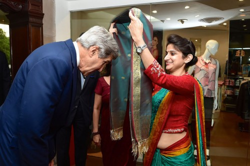 Secretary Kerry Participates in Traditional Scarf Ceremony Upon Arriving in India For Strategic and Economic Dialogue U.S. Secretary of State John Kerry bows to receive a scarf during a traditional arrival ceremony at his hotel in New Delhi, India, on July 30, 2014, after he traveled for a Strategic Dialogue with Commerce Secretary Penny Pritzer. [State Department photo/ Public Domain]