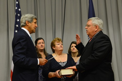 U.S. Secretary of State John Kerry hosts a swearing-in ceremony for U.S. Ambassador to Russia John Tefft at the U.S. Department of State in Washington, DC on September 2, 2014. [State Department photo/ Public Domain]