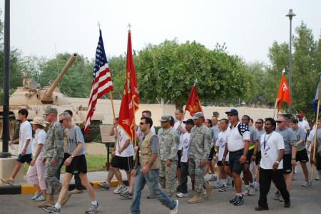 U.S. Ambassador to Kuwait, Deborah K. Jones and Brig. Gens. William Frink and James Walton, commander, 311th Sustainment and 335th Signal Commands, lead over 500 participants during the Freedom Walk held at the U.S. Embassy in Kuwait, Sept 11, 2008.
