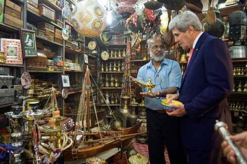 Shopkeeper Offers Oil Lamp as Secretary Kerry Pays Visit to Muttrah Souk in Oman A shopkeeper offers an oil lamp to U.S. Secretary of State John Kerry as he visits the Muttrah Souk - a traditional bazaar - in Muscat, Oman, on November 10, 2014, during a break in P5+1 negotiations with Iran about the future of its nuclear program. [State Department photo/ Public Domain]
