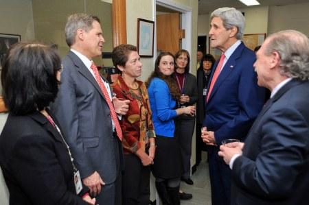 U.S. Secretary of State John Kerry speaks with U.S. Ambassador to Yemen Matthew Tueller