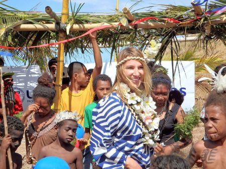 Deputy Secretary of State for Management and Resources Heather Higginbottom meets with community members in Boera, Papua New Guinea, on September 10, 2015, to learn about climate change impacts on the community and to join them in celebrating with Motuan cultural songs, dances, and history. Earlier in the day, Deputy Secretary Higginbottom launched a USAID Coastal Community Adaptation Project (C-CAP), which will build the resilience of vulnerable coastal communities in the Pacific region to withstand more intense and frequent weather events and ecosystem degradation in the short term and sea level rise in the long term. [State Department photo/ Public Domain]