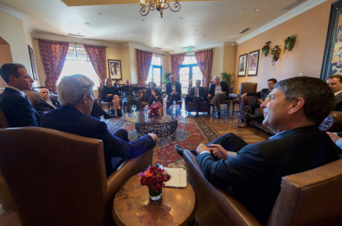 U.S. Secretary of State John Kerry, flanked by Universal Filmed Entertainment Group Chairman Jeff Shell, meets with a group of movie industry executives during a visit to Universal Studios in Burbank, California, on February 16, 2016. [State Department photo/ Public Domain]