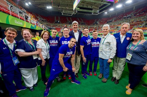 Secretary Kerry Poses For A Photo with the U.S. Men's Gymnastics Team U.S. Secretary of State John Kerry and fellow members of the U.S. Presidential Delegation to the Summer Olympics pose for for a photo with the U.S. men's Olympic gymnastics team on August 6, 2016, at Olympic Park in Rio de Janiero, Brazil. [State Department Photo/ Public Domain]